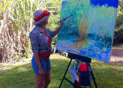 rita-schwab-artist-acres-with-artist-at-work