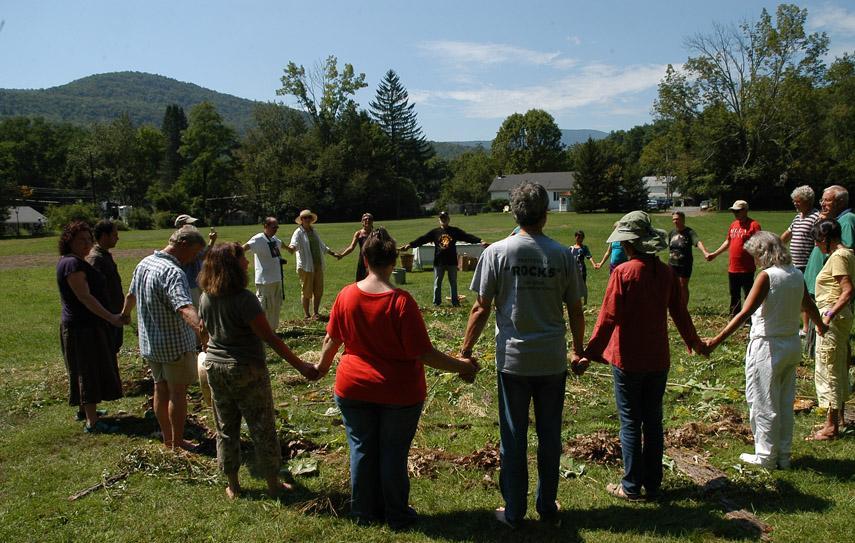 Gratitude Circle with community built organic mandala.