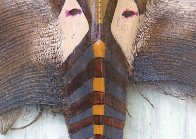 rita-schwab-elephant-mask-on-coconut-palm-frond